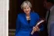 La première ministre britannique, Theresa May, à son départ du 10 Downing Street vers les débats à la Chambre des communes, le 20 juin.