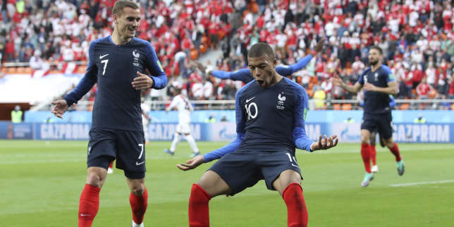 France's Kylian Mbappe, left celebrates with =teammate France's Antoine Griezmann after scoring the opening goal of the game during the group C match between France and Peru at the 2018 soccer World Cup in the Yekaterinburg Arena in Yekaterinburg, Russia, Thursday, June 21, 2018. (AP Photo/David Vincent)