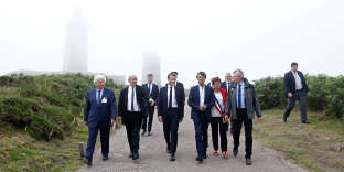 From 2ndL-3rdR, French Foreign Affairs Minister Jean-Yves Le Drian, French President Emmanuel Macron and Nicolas Hulot, French Minister for the Ecological and Inclusive Transition, visit the Cap Frehel peninsula in northern Brittany, France, June 20, 2018. REUTERS/Stephane Mahe