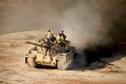 Des combattants rebelles syriens à Deraa, le 23 juin.