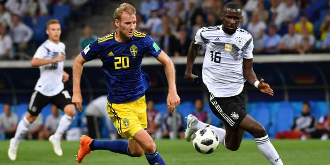 Sweden's forward Ola Toivonen (L) scores the opening goal during the Russia 2018 World Cup Group F football match between Germany and Sweden at the Fisht Stadium in Sochi on June 23, 2018. RESTRICTED TO EDITORIAL USE - NO MOBILE PUSH ALERTS/DOWNLOADS / AFP / Nelson Almeida / RESTRICTED TO EDITORIAL USE - NO MOBILE PUSH ALERTS/DOWNLOADS