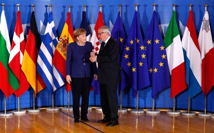 Le président de la Commission européenne, Jean-Claude Juncker, et la chancelière allemande, Angela Merkel, à Bruxelles, le 24 juin.