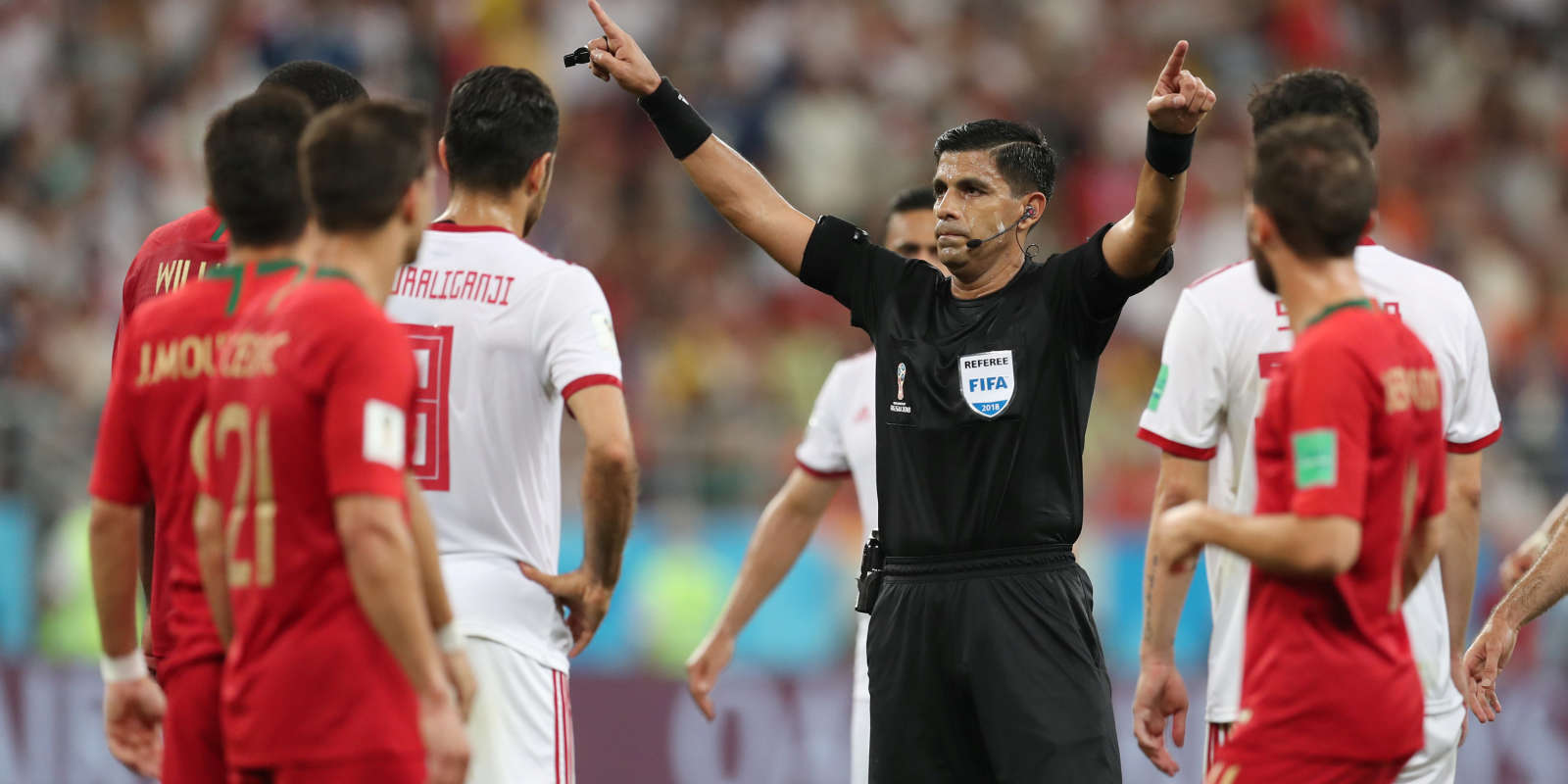 Soccer Football - World Cup - Group B - Iran vs Portugal - Mordovia Arena, Saransk, Russia - June 25, 2018 Referee Enrique Caceres reviews a incident on VAR before awarding Iran a penalty REUTERS/Ricardo Moraes