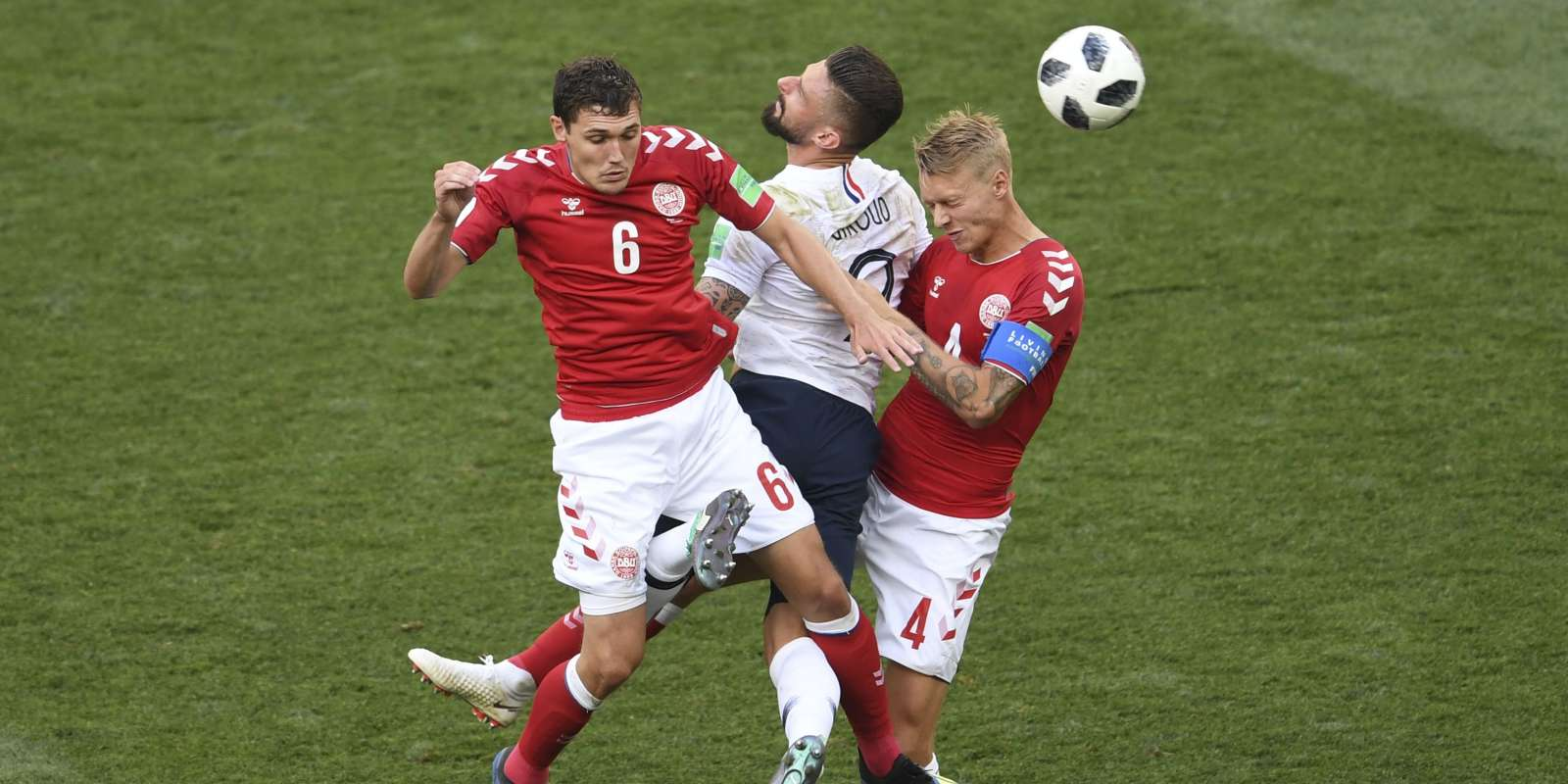 France's forward Olivier Giroud (C) vies for the header with Denmark's defender Andreas Christensen (L) and Denmark's defender Simon Kjaer during the Russia 2018 World Cup Group C football match between Denmark and France at the Luzhniki Stadium in Moscow on June 26, 2018. RESTRICTED TO EDITORIAL USE - NO MOBILE PUSH ALERTS/DOWNLOADS / AFP / YURI CORTEZ / RESTRICTED TO EDITORIAL USE - NO MOBILE PUSH ALERTS/DOWNLOADS