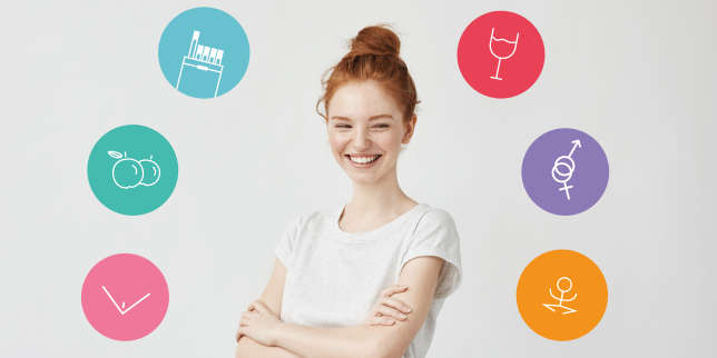 Portrait of happy young beautiful redhead girl laughing. Copy space. Isolated on white background.