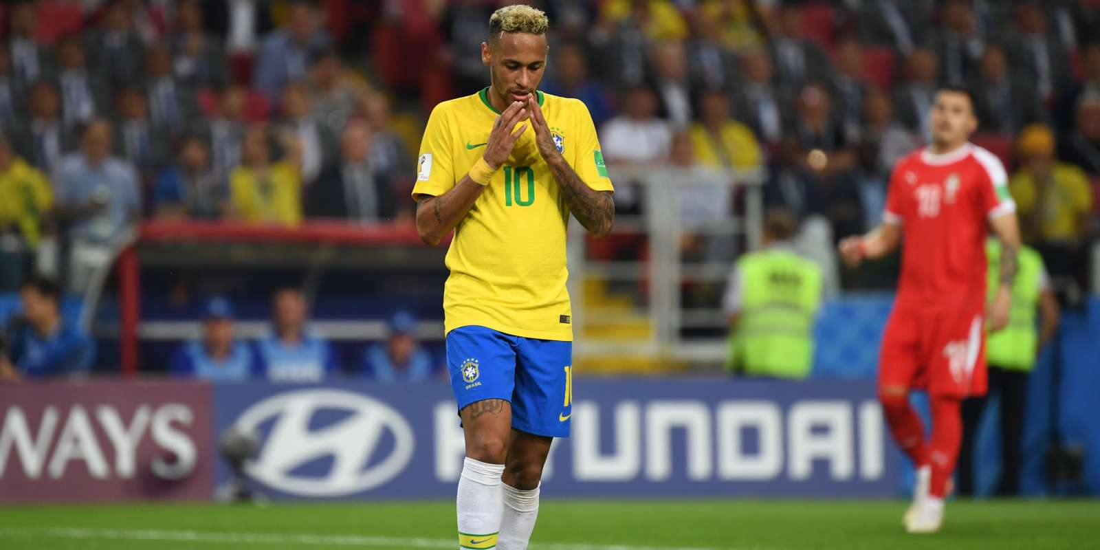 Brazil's forward Neymar reacts during the Russia 2018 World Cup Group E football match between Serbia and Brazil at the Spartak Stadium in Moscow on June 27, 2018. RESTRICTED TO EDITORIAL USE - NO MOBILE PUSH ALERTS/DOWNLOADS / AFP / Kirill KUDRYAVTSEV / RESTRICTED TO EDITORIAL USE - NO MOBILE PUSH ALERTS/DOWNLOADS