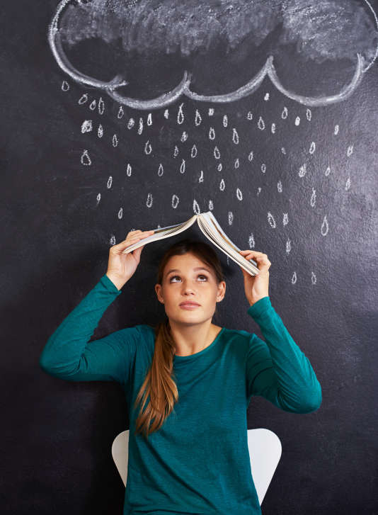 Cropped shot of an attractive young woman standing in front of a blackboard