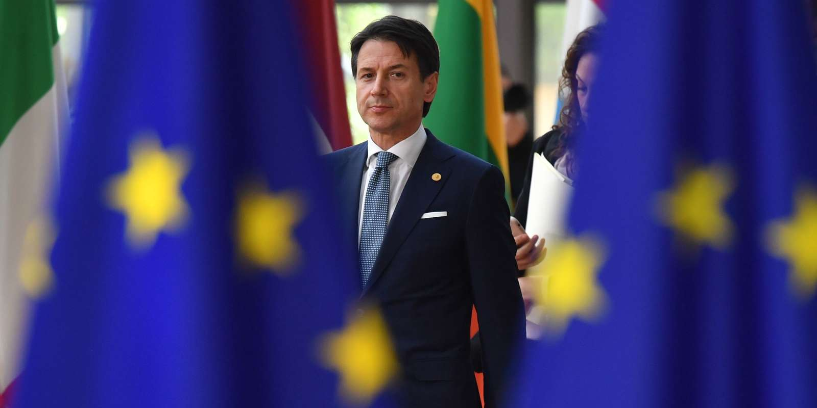 Italian Prime Minister Giuseppe Conte arrives to take part in an European Union leaders' summit focused on migration, Brexit and eurozone reforms on June 28, 2018 at the EU headquarters in Brussels. The two-day meeting in Brussels is expected to be dominated by deep divisions over migration, with German Chancellor saying the issue could decide the fate of the bloc itself. / AFP / Ben STANSALL