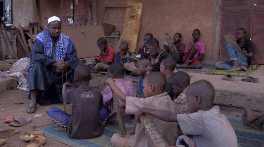 Elèves dans une école coranique, au Mali, en 2018.