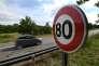 Nouveau panneau de limitation de vitesse sur une route de l'Est de la France;