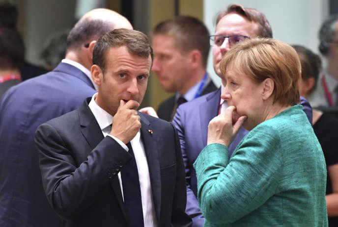 Le président français, Emmanuel Macron, et la chancelière allemande, Angela Merkel, lors du sommet européen organisé le 28 juin, à Bruxelles.
