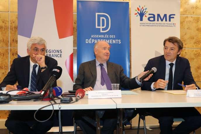 De gauche à droite : Hervé Morin, président de Régions de France, Dominique Bussereau, président de l'Association des départements de France, et François Baroin, président de l'association des maires de France, à Paris, le 3 juillet.