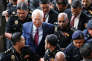 L'ex-premier ministre malaisien Najib Razak est conduit au tribunal de Kuala Lumpur, mercredi 4 juillet.