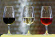 Glasses of Belgian red wine Saint-Remi, white wine Le Vin de Jean and rose Les Notes Rosees are displayed at the Domaine du Chapitre in Baulers, Belgium July 6, 2018. REUTERS/Yves Herman