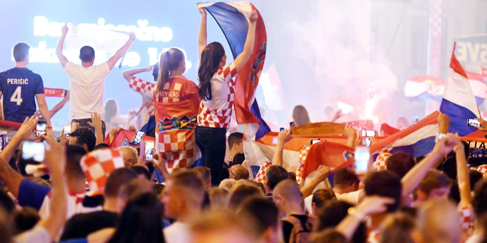 Croatia's fans celebrate victory against Russia in the Croatian capital Zagreb's main square after the 2018 FIFA World Cup Russia Round of 8 match between Russia and Croatia on July 7, 2018. / AFP / Denis Lovrovic