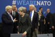 FILE - In this May 25, 2017, file photo, U.S. President Donald Trump jokes with British Foreign Minister Boris Johnson as British Prime Minister Theresa May walks past during a working dinner meeting at the NATO headquarters during a NATO summit of heads of state and government in Brussels. Threatening to upend generations of global order, Trump's week-long European trip will test the strained bonds with some of the United States' closest allies before putting him face-to-face with the leader of the country whose electoral interference helped put him in office. (AP Photo/Matt Dunham, Pool)