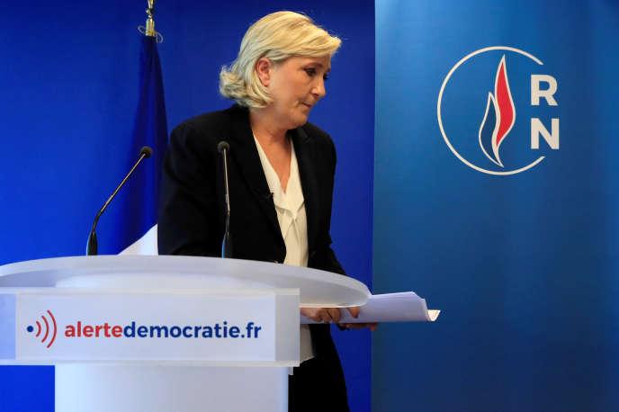 Marine Le Pen, présidente du Rassemblement National, lors d'une conférence de presse, à Nanterre, le 9 juillet.