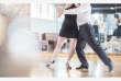 Couple dancing salsa in studio