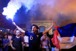 Soccer Football - World Cup - Semi-Final - France vs Belgium - Paris, France, July 10, 2018 - France fans react on the Champs-Elysees after defeating Belgium in their World Cup semi-final match. REUTERS/Gonzalo Fuentes