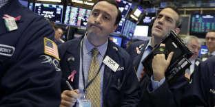 Des traders à la Bourse de New York mardi 10 juillet