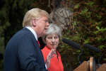 "US President Donald Trump (L) gestures as Britain's Prime Minister Theresa May (R) listens during a press conference following their meeting at Chequers, the prime minister's country residence, near Ellesborough, northwest of London on July 13, 2018 on the second day of Trump's UK visit. US President Donald Trump launched an extraordinary attack on Prime Minister Theresa May's Brexit strategy, plunging the transatlantic ""special relationship"" to a new low as they prepared to meet Friday on the second day of his tumultuous trip to Britain. / AFP / POOL / Stefan Rousseau"