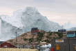 An iceberg floats near the Innaarsuit settlement, Greenland July 10, 2018 in this image obtained from social media. Picture taken July 10, 2018. Lucia Ali Nielsen via REUTERS ATTENTION EDITORS - THIS IMAGE WAS PROVIDED BY A THIRD PARTY. MANDATORY CREDIT: LUCIA ALI NIELSEN