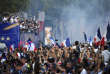 France's players celebrate on the roof of a bus while parading down the Champs-Elysee avenue in Paris, Monday, July 16, 2018. France is readying to welcome home the national soccer team for a parade down the Champs-Elysees, where tens of thousands thronged after the team's 4-2 victory over Croatia Sunday. (Eric Feferberg/Pool Photo via AP)