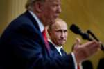 "Russia's President Vladimir Putin listens while US President Donald Trump speaks during a press conference at Finland's Presidential Palace July 16, 2018 in Helsinki, Finland. The US and Russian leaders opened an historic summit in Helsinki, with Donald Trump promising an ""extraordinary relationship"" and Vladimir Putin saying it was high time to thrash out disputes around the world.  / AFP / Brendan Smialowski"