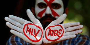 FILE PHOTO: A student displays his hands painted with messages as he poses during an HIV/AIDS awareness campaign to mark the International AIDS Candlelight Memorial, in Chandigarh, India, May 20, 2018. REUTERS/Ajay Verma/File Photo