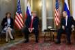(FILES) In this file photo taken on July 16, 2018 Russian President Vladimir Putin (R) and US President Donald Trump (2L) attend a meeting in Helsinki, on July 16, 2018. US Democratic lawmakers on July 19, 2018, pushed for Congress to subpoena Trump's interpreter, Marina Gross (L), amid a growing sense of alarm over the private summit in Helsinki between Trump and Putin. The two presidents held a two-hour closed-door negotiation with no other officials present save for the leaders' interpreters. 