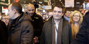 Le président des Patriotes, Florian Philippot, et Sophie Montel avant qu'elle ne quitte le parti, au Salon de l'agriculture à Paris, le 27 février.