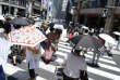 People under parasols walk on a pedestrian crossing in Tokyo Friday, July 20, 2018. A deadly heat wave in Japan has many residents in the Japanese capital questioning the wisdom of staging the Tokyo 2020 Olympics in July and August. (AP Photo/Eugene Hoshiko)