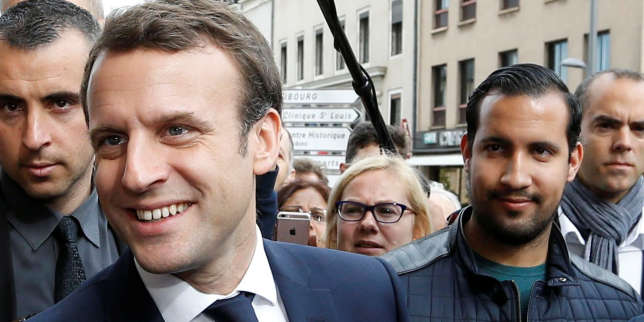 Emmanuel Macron (L), head of the political movement En Marche !, or Onwards !, and candidate for the 2017 presidential election, flanked by Alexandre Benalla (R), head of security, attends a campaign visit in Rodez, France, May 5, 2017. Picture taken May 5, 2017 . REUTERS/Regis Duvignau
