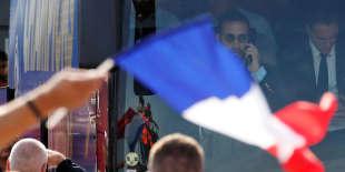 Alexandre Benalla, dans le bus des joueurs de l'équipe de France, lundi 16 juillet.