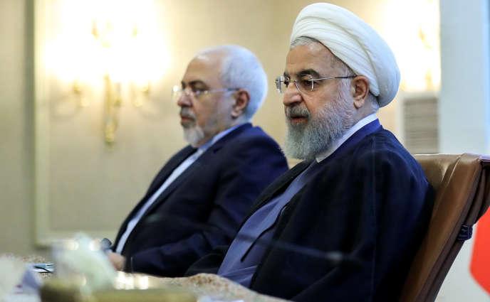 Le président iranien Hassan Rohani et le ministre des affaires étrangères Mohammad Javad Zarif à Téhéran le 22 juillet.