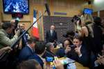 France's Interior Minister Gerard Collomb poses for the press as he arrives to appear before the Law Commission of the lower house of parliament on July 23, 2018, in Paris, following media reports that suggested he knew about an assault by a top presidential security aide but kept quiet.   Collomb is appearing before parliament as opposition MPs accused the government of a cover-up over a former top presidential security aide Alexandre Benalla who was charged with gang violence. Benalla, 26, was fired July 20, after video footage emerged showing him hitting a man at least twice as riot police looked on while breaking up a May Day protest in Paris. / AFP / GERARD JULIEN