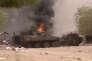 Un véhicule blindé est en feu, après une attaque à la voiture piégée, à Gao, au Mali, le 1er juillet. Arrêt sur image d'une vidéo.