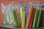 This July 17, 2018 photo shows wrapped plastic straws at a bubble tea cafe in San Francisco. Eco-conscious San Francisco joins the city of Seattle in banning plastic straws, along with tiny coffee stirrers and cup pluggers, as part of an effort to reduce plastic waste. It also makes single-use food and drink side items available upon request and phases out the use of fluorinated wrappers and to-go containers. (AP Photo/Jeff Chiu)