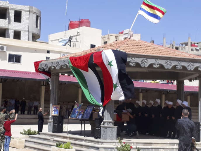 Dans la province de Souweïda, le 26 juillet, lors des funérailles des victimes des attaques menées la veille par l'organisation Etat islamique.