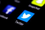 FILE PHOTO: The Twitter application is seen on a phone screen August 3, 2017.   REUTERS/Thomas White/File Photo