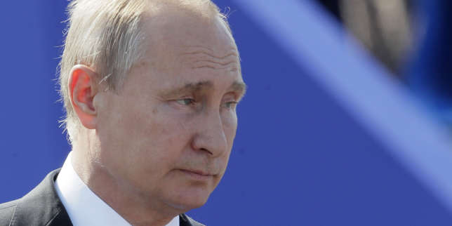 Russian President Vladimir Putin attends the military parade during the Navy Day celebration in St.Petersburg, Russia, Sunday, July 29, 2018. (AP Photo/Dmitri Lovetsky)