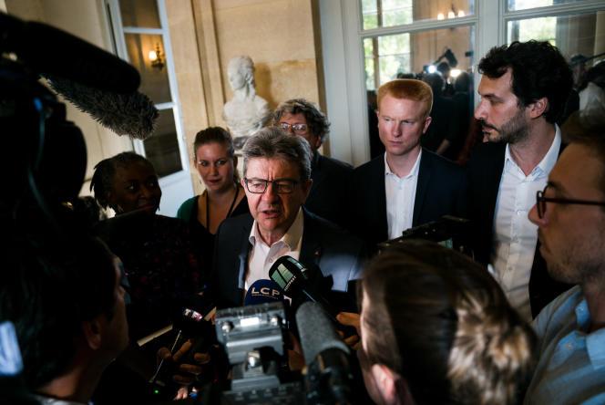 Autour de Jean Luc Melenchon qui repond aux journalistes dans la salle des Quatre colonnes, le 31 juillet, les deputes Daniele Obono, Mathilde Panot, Eric Coquerel, Adrien Quatennens et Bastien Lachaud.