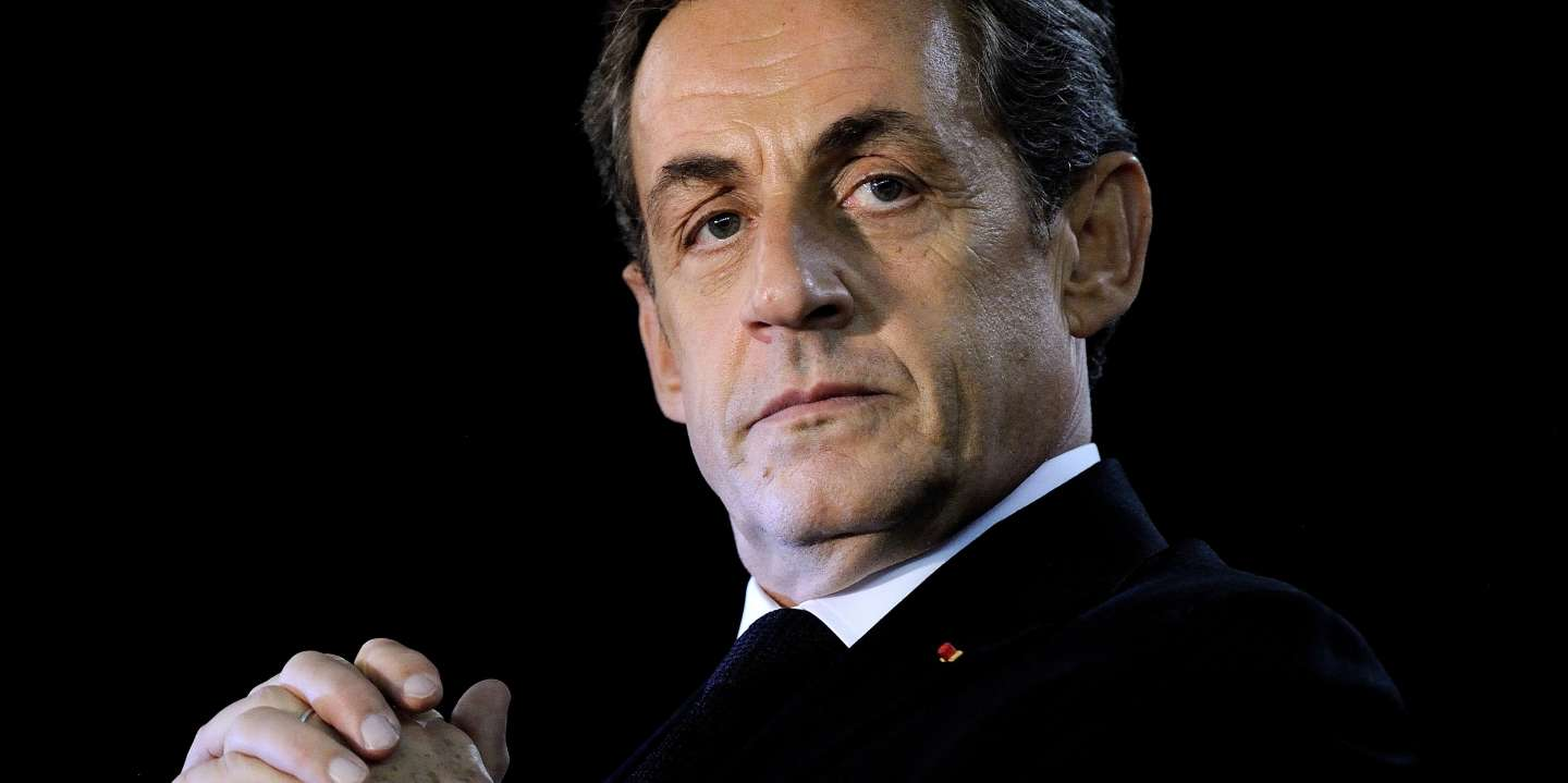 (FILES) In this file photograph taken on November 24, 2014, former French president Nicolas Sarkozy looks on during his rally as candidate for the presidency of the French right-wing main opposition party UMP in Andard, near Angers, western France.  The Paris Court of Appeal is set to examine on May 16, 2018, the appeal of former President Nicolas Sarkozy against his referral to the Criminal Court in the case of excessive spending of his 2012 presidential campaign and the false invoices of society. / AFP / JEAN-SEBASTIEN EVRARD