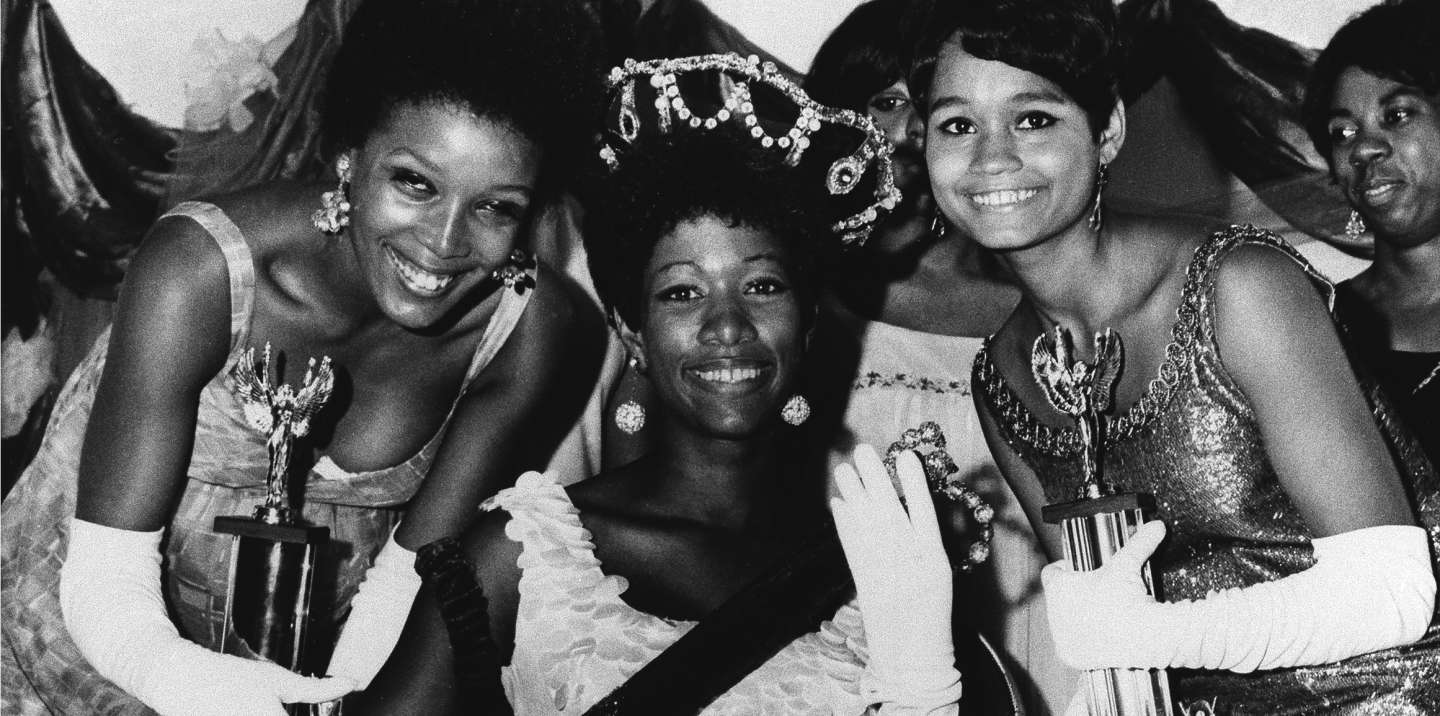 Saundra Williams, 19, center, of Philadelphia, Pa., was crowned Miss Black America 1969 at ceremonies in Atlantic City, Sept. 8, 1969. Linda Johnson, 21, left, also of Philadelphia, was chosen second runner-up, while Theresa Claytor, 20, right, of Washington, D.C. was first runner-up. Miss Williams was crowned a little over 2 hours after Judith Ann Ford, of Belvedere, Ill., was chosen Miss America 1969 at Convention Hall. (AP Photo)