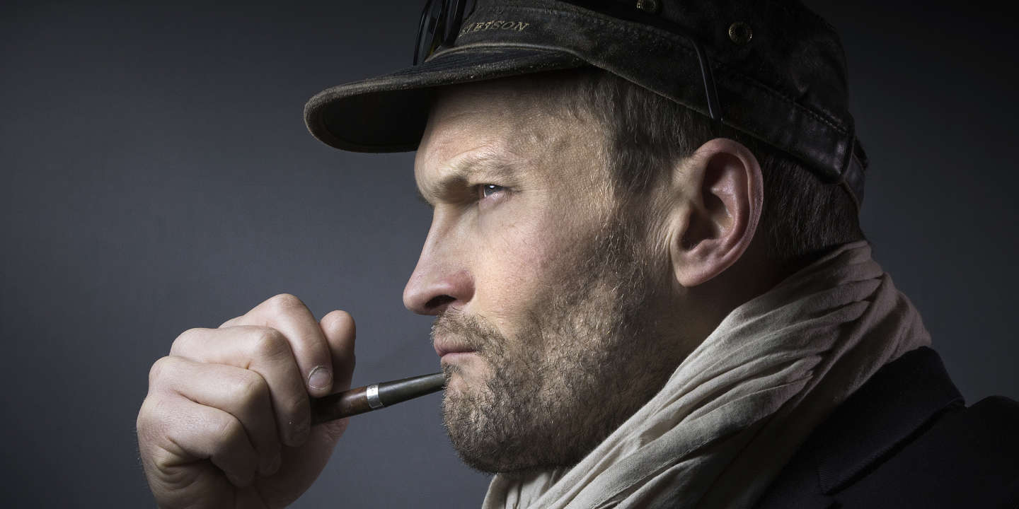 French writer Sylvain Tesson poses with a pipe during the presentation of the
