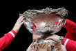 FILE PHOTO: Switzerland's team members hold the trophy after winning the Davis Cup final against France at the Pierre-Mauroy stadium in Villeneuve d'Ascq, near Lille, November 23, 2014. REUTERS/Gonzalo Fuentes/File Photo