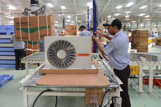 Dans une entreprise indienne de fabrication de climatiseurs, en mai 2013.
