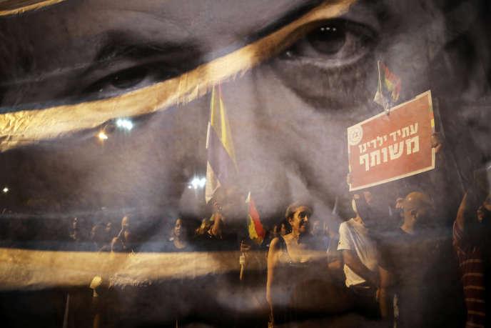 Des Israéliens de la minorité druze manifestent contre la loidéfinissant le pays comme «Etat-nation du peuple juif», à Tel-Aviv, le 4 août.