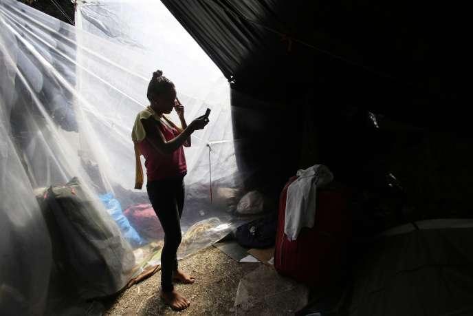 Une femme vénézuélienne à la frontière avec l'Equateur, le 9 août.