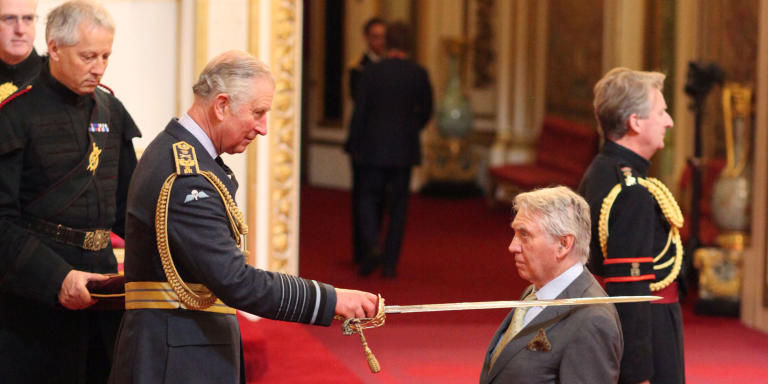 Sir Don McCullin is knighted by the Prince of Wales during an Investiture ceremony at Buckingham Palace, London.